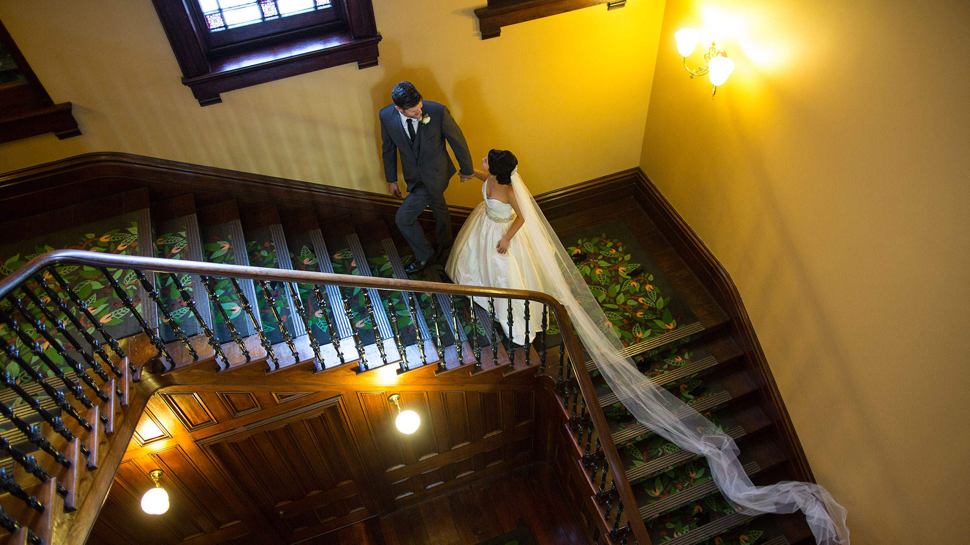 Married couple ascending the stairs
